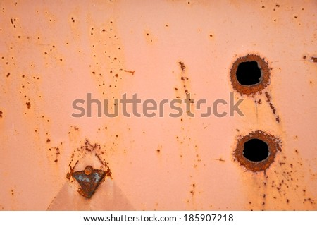 Rusty metal background with bullet hole - stock photo