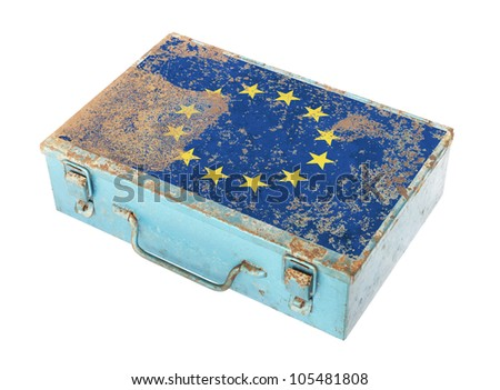 Rusty metal box with European flag on lid isolated on white background