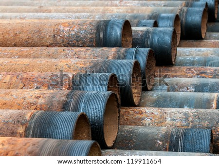 Rusty metal pipe with threads visible - stock photo