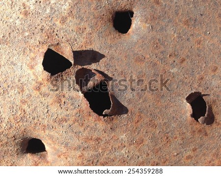 Rusty Metal Plate-Riddled with Bullets - stock photo