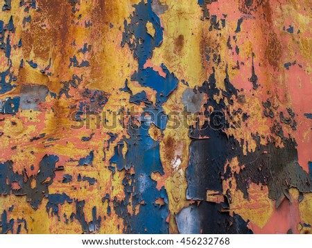 Rusty metal plate with blue paint chipping off