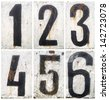 Rusty metal plate with numbers - stock photo