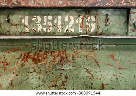 rusty metal plate with numbers - corroded texture background - stock photo