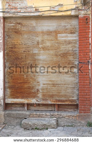 Rusty Metal Roll Blinds at Closed Shop in Skopje