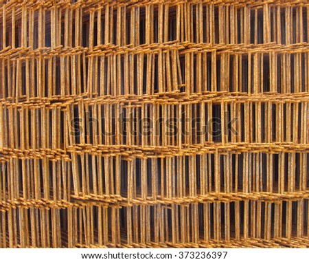rusty metal stacked grid on industrial construction site