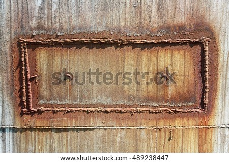 Rusty metal surface with welding patch