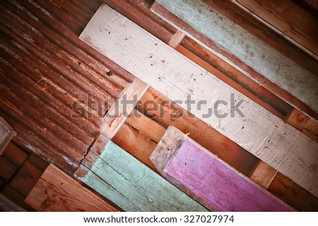 Rusty metal with colour wood for background and texture - stock photo
