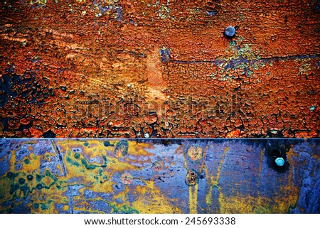rusty metallic background with shabby and old shabby paint - stock photo
