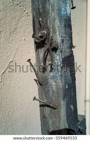 Rusty nail on Eucalyptus post for holding together old wood post.