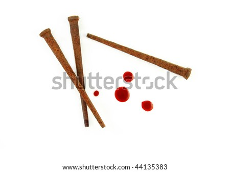 Rusty Nails and drops of blood on a white background.