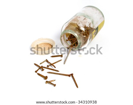 Rusty nails in a jar, on white background - stock photo