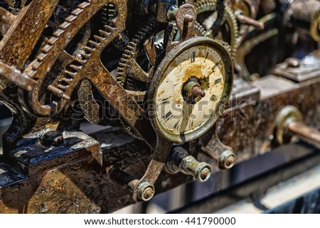 rusty old clockwork large clock with damaged dial - stock photo