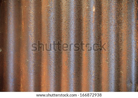 Rusty old corrugated iron fence close up - stock photo