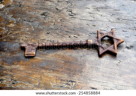 rusty old key from the Synagogue - stock photo