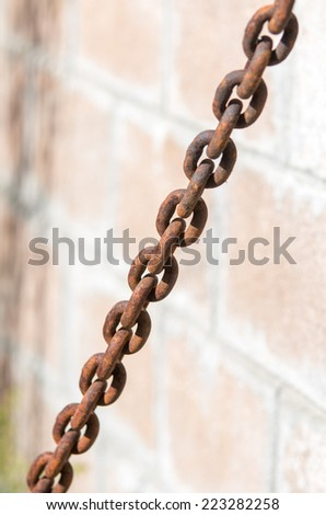 Rusty old metal chain in daylight - stock photo