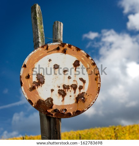Rusty Old No Vehicles Traffic Sign Against The Blue Sky - stock photo