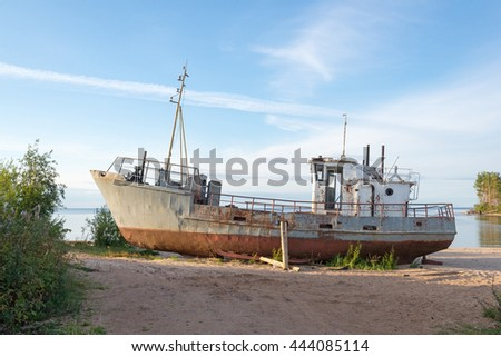 rusty old ship on the shore