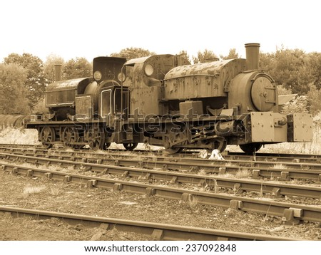 rusty old steam engines - stock photo