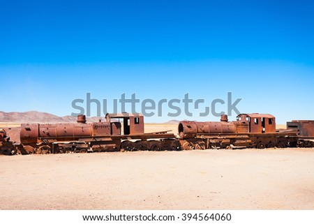 Rusty old steam train at the Train Cemetery, Salar de Uyuni, Bolivia - stock photo