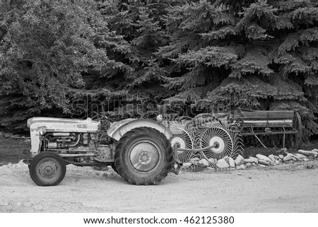 Rusty old tractor in black and white in rural Utah, USA.