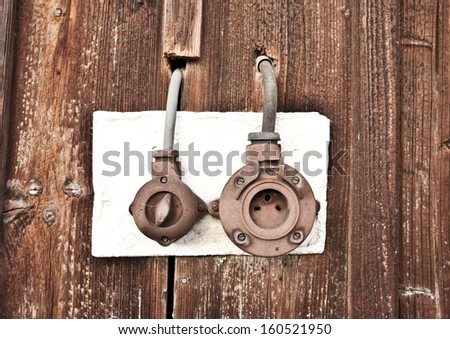 Rusty old vintage power plug - stock photo