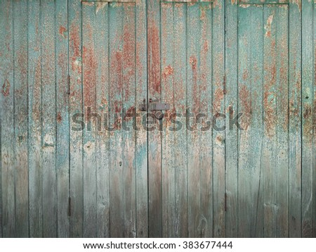 rusty on the old green wood door for background texture - stock photo