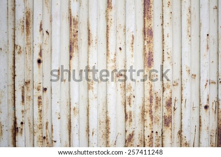 Rusty orange metal doors metal texture - stock photo