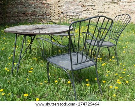 rusty outdor furniture in the yard another view - stock photo