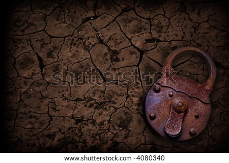 rusty padlock with a crackled background - stock photo