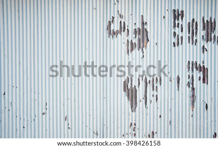 rusty piece of corrugated metal - stock photo