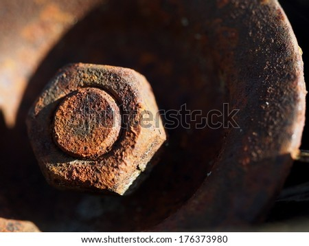 Rusty piece of metal and screw - stock photo