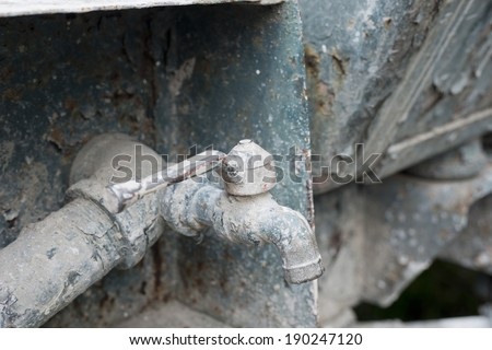 rusty pipe and valve,at building site - stock photo
