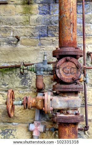 Rusty Pipes, Dean Clough Mills, Halifax, Calderdale, UK - stock photo