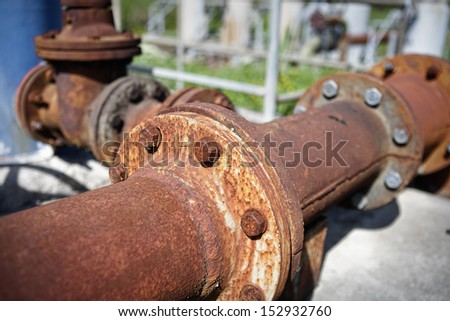 Rusty pipes. Detail of steel pipes of a larger abandoned installation. - stock photo