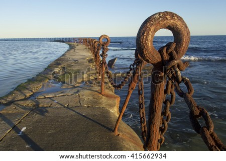 Rusty Posts and Chain at the Sea Baths, Newcastle, NSW, Australia - stock photo