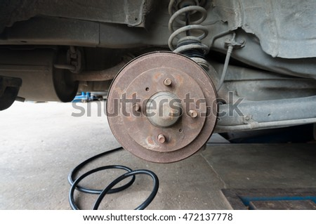 Rusty Rear Car Wheel Hub with Drum Brake System and Suspension