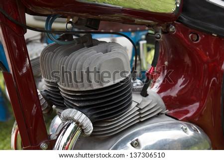 rusty retro motorcycle engine cylinder - stock photo