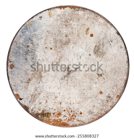 Rusty round metal plate isolated on white