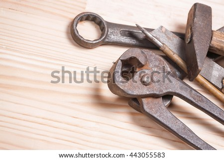 Rusty rugged old work industrial tools key wrench screw driver light natural wooden background
