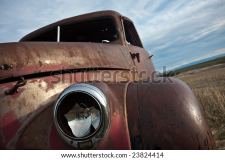 Rusty 1940's truck out in the field - stock photo