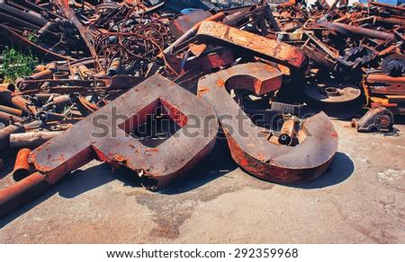 Rusty scrap metal in the yard - stock photo