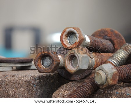 Rusty screws, nuts, and washers