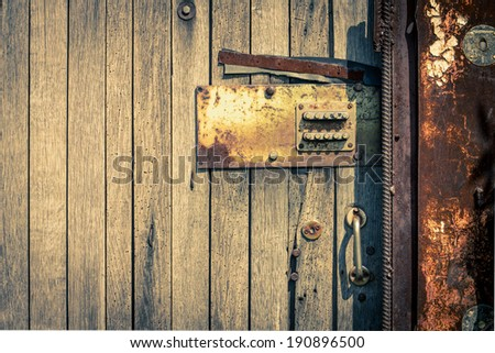 Rusty Security Lock at the Old Wooden Door - stock photo