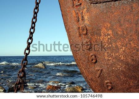 Rusty ship and sky - stock photo
