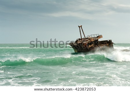 Rusty Ship On Rough Sea In South Africa