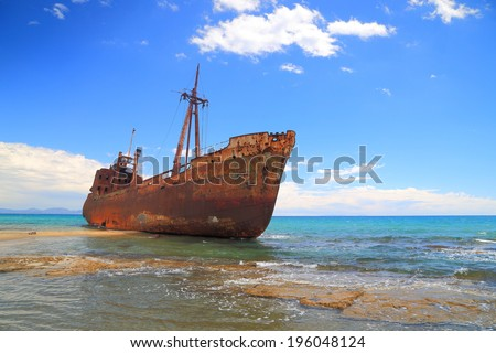Rusty ship wreck on sunny Selinitsa beach near Gytheio, Greece - stock photo