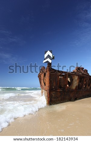 Rusty shipwreck on tropical beach - the Maheno, Fraser Island, Queensland, Australia - stock photo