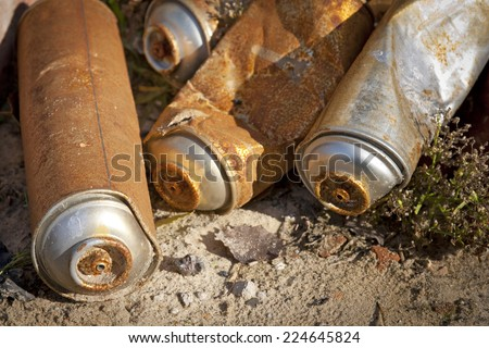 Rusty Spray Cans. It is a detail of a street art and graffiti. Some of used and empty aerosol cans. - stock photo