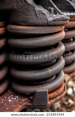 Rusty springs of railway industrial carriage. - stock photo