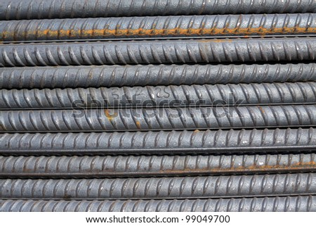 rusty steel bars construction materials, in a construction site - stock photo